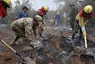 Soldiers, firemen and volunteers combat forest fires near Robore in eastern Bolivia, on August 25, 2019