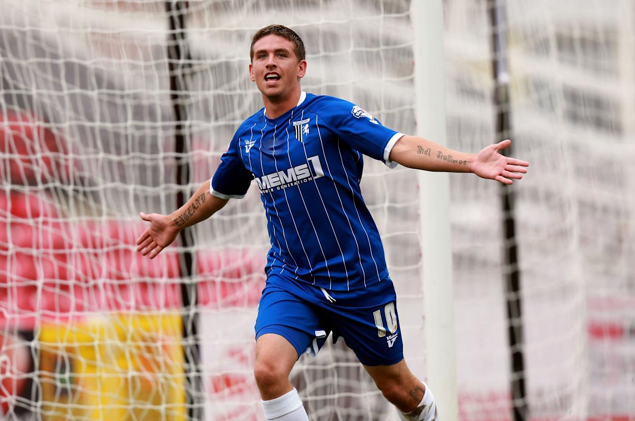 Gillingham's Cody McDonald celebrates scoring their second goal during the Sky Bet Football League One match at the County Ground, Swindon.