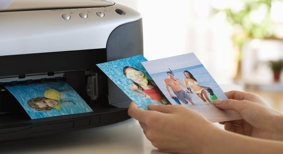 This home printer comes with ink and is ready to use. (Getty Images)