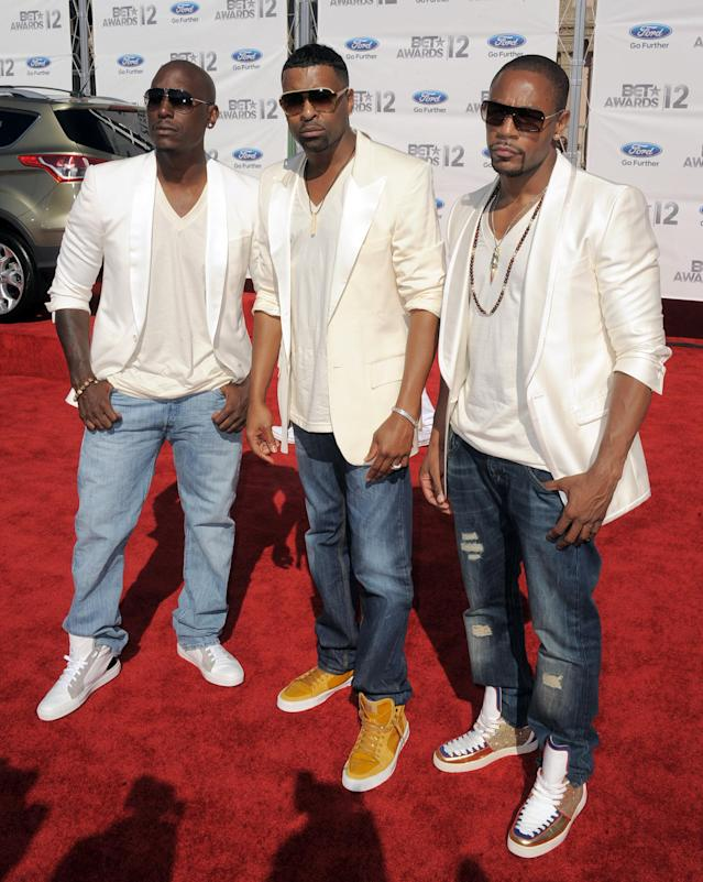 From left, Tyrese Gibson, Ginuwine and Tank, of musical group TGT, arrive at the BET Awards on Sunday, July 1, 2012, in Los Angeles. (Photo by Jordan Strauss/Invision/AP)