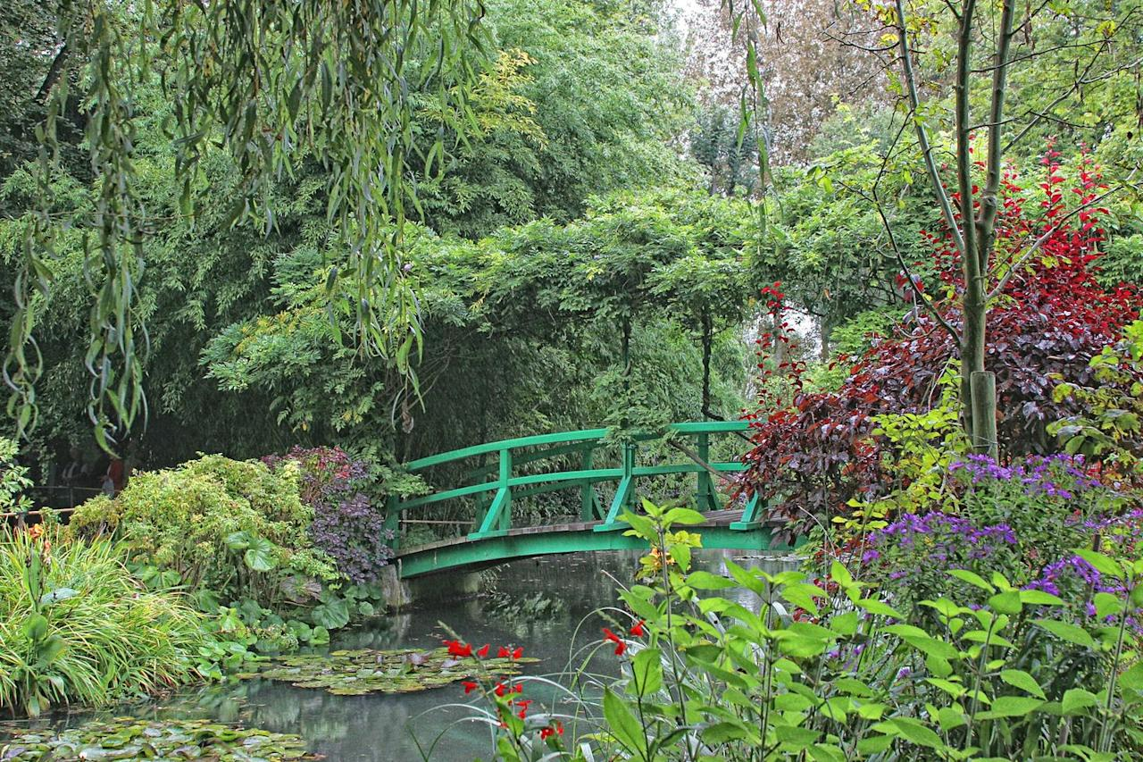"""<p>Monet's Water Lilies, a series of 250 paintings, were all inspired by his beautiful garden in Giverny, Normandy. He reportedly fell in love with the village when he saw it from a train window. The famous painting, The Water Lily Pond, features a Japanese bridge arching over the lily pads. He spent his last 30 years of painting being inspired by the stunning gardens and the translucent light. Claude Monet himself said: 'My garden is my most beautiful work of art.'</p><p><a class=""""body-btn-link"""" href=""""https://www.youtube.com/watch?v=rjWx2WNXFF4"""" target=""""_blank"""">Take a virtual tour</a></p>"""
