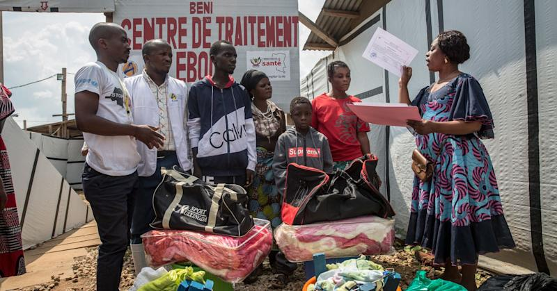 A young boy is handed a certificate confirming he is Ebola-free, outside the Ebola treatment centre in Beni, eastern Democratic Republic of the Congo.
