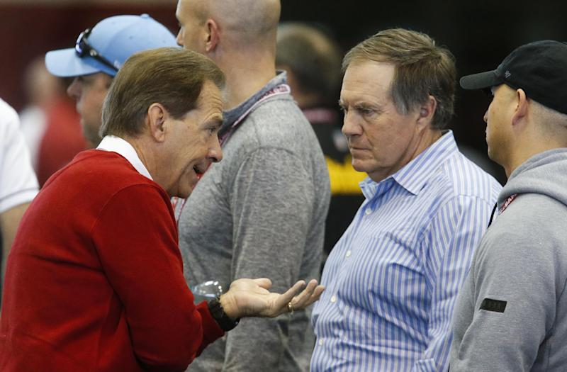 Bill Belichick (middle) and Alabama head coach Nick Saban share some thoughts at the Crimson Tide's pro day. (AP)