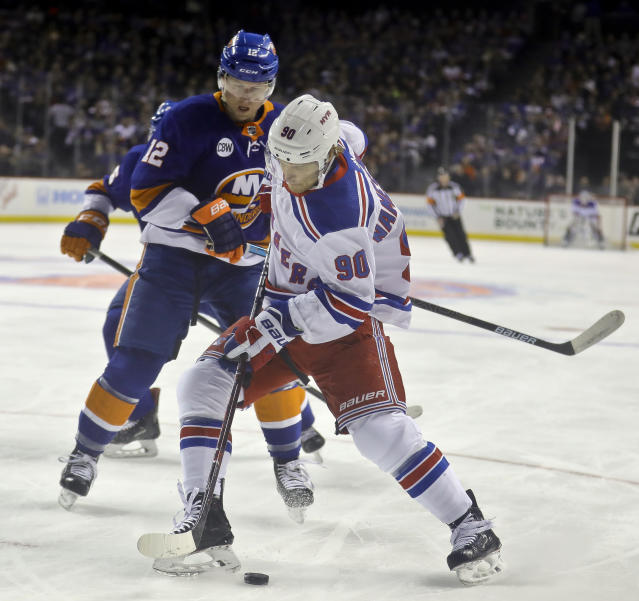 New York Rangers' Vladislav Namestnikov (90) moves puck against New York Islanders' Josh Bailey (12) during the first period of na NHL hockey game, Saturday, Jan. 12, 2019, at Barclays Center in New York. (AP Photo/Bebeto Matthews)