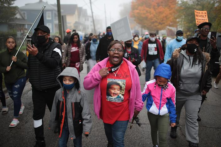 Demonstrators protest the October 20, police shooting that led to the death of 19-year-old Marcellis Stinnette and left his girlfriend, 20-year-old Tafara Williams, with serious injuries on October 22, 2020 in Waukegan, Illinois.