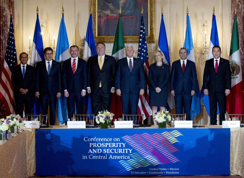 From left; Vice President Oscar Ortiz of El Salvador, Hondura's President Juan Orlando Hernandez, Mexico's Foreign Secretary Luis Videgaray, Secretary of State Mike Pompeo, Vice President Mike Pence, Secretary of Homeland Security Kirstjen Nielsen, Mexico's Secretary of Government Alfonso Navarrete and Guatemala's President Jimmy Morales pose for a photos before the second Conference for Prosperity and Security in Central America at State Department on Thursday, Oct. 11, 2018, in Washington. (AP Photo/Jose Luis Magana)