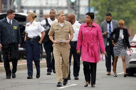 Washington DC Mayor Muriel Bowser (R, in pink coat) and U.S. Navy Vice-Admiral Dixon Smith (center L) arrive to address the media following a lockdown at the U.S. Navy Yard in Washington July 2, 2015. REUTERS/Jonathan Ernst