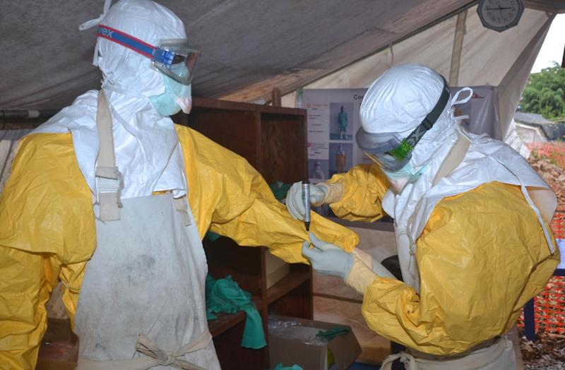 Guinea health workers at an Ebola treatment centre in Conakry on December 8, 2014