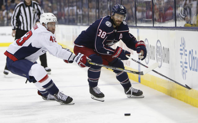 Washington Capitals' Tom Wilson, left, and Columbus Blue Jackets' Boone Jenner chase the puck during the second period of Game 6 of an NHL first-round hockey playoff series Monday, April 23, 2018, in Columbus, Ohio. (AP Photo/Jay LaPrete)