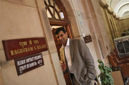 India's then chief economic adviser Raghuram Rajan stands outside his room at the finance ministry in New Delhi August 6, 2013. REUTERS/Adnan Abidi/Files