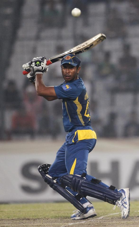 Sri Lanka's Kithuruwan Vithanage plays a ball against Bangladesh during their third one day international (ODI) cricket match of the series in Dhaka February 22, 2014. REUTERS/Andrew Biraj (BANGLADESH - Tags: SPORT CRICKET)