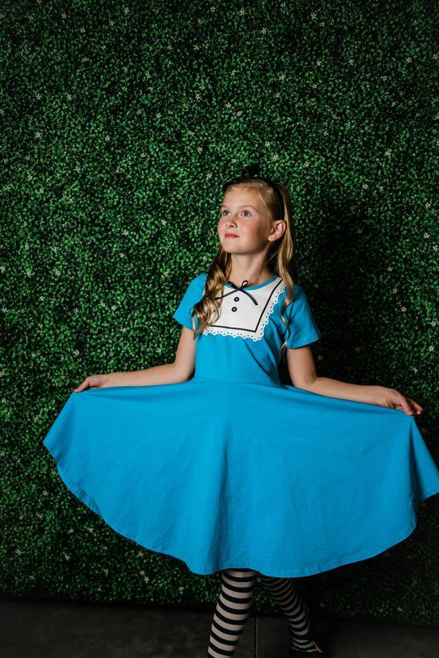"<p>Thanks to the soft t-shirt material, this sweet, blue Alice dress is a comfortable choice for trick-or-treating.</p><p><strong> Get the tutorial at <a href=""https://www.sisterssuitcaseblog.com/no-sew-alice-in-wonderland-costumes/"" rel=""nofollow noopener"" target=""_blank"" data-ylk=""slk:My Sister's Suitcase"" class=""link rapid-noclick-resp"">My Sister's Suitcase</a>.</strong></p><p> <a class=""link rapid-noclick-resp"" href=""https://www.amazon.com/Viishow-Womens-Swing-Casual-T-Shirt/dp/B079DK7J2P/ref=sr_1_5?tag=syn-yahoo-20&ascsubtag=%5Bartid%7C10050.g.29343502%5Bsrc%7Cyahoo-us"" rel=""nofollow noopener"" target=""_blank"" data-ylk=""slk:SHOP BLUE DRESSES"">SHOP BLUE DRESSES</a><br></p>"