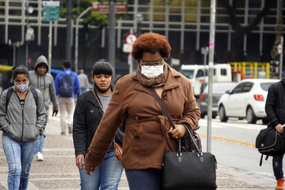 People walk in Sao Paulo, Brazil, on July 29, 2021 during a cold day. (Photo by Cris Faga/NurPhoto via Getty Images)