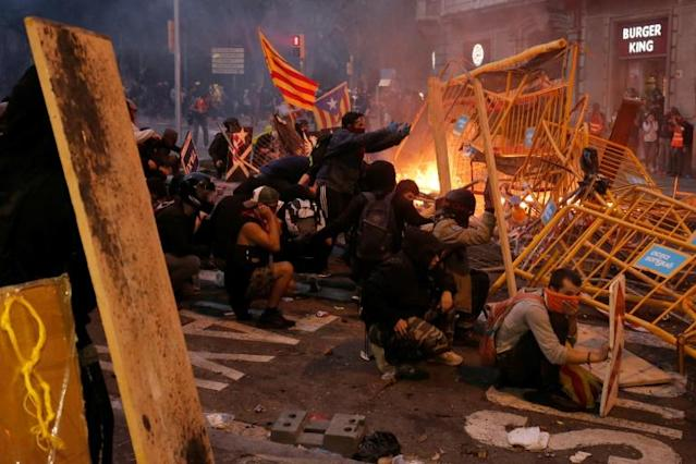 Nearly 600 people have been injured in clashes with police since the Catalonia protests started (AFP Photo/Pau Barrena)