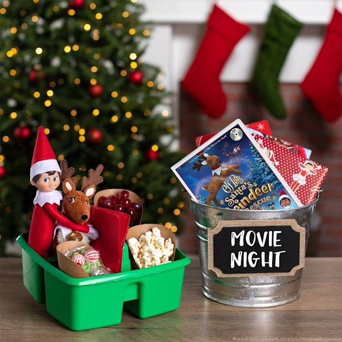 """<p>It's the perfect opportunity to watch all of your favorite Christmas movies: Host a movie night! Don't forget the miniature snacks for your Elf and his friends. </p><p><strong>Get the tutorial at <a href=""""https://elfontheshelf.com/elf-ideas/christmas-movie-night-tips"""" rel=""""nofollow noopener"""" target=""""_blank"""" data-ylk=""""slk:The Elf on the Shelf"""" class=""""link rapid-noclick-resp"""">The Elf on the Shelf</a>.</strong></p>"""