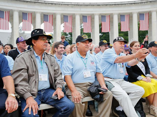 <p>From left, Cruzer Cruz, Manny Soto, Ron Anderson, and other members of Honor Flight Austin take their seats at the Memorial Amphitheater in Arlington National Cemetery in Arlington, Va., May 29, 2017, before the start of a Memorial Day ceremony. (Photo: Pablo Martinez Monsivais/AP) </p>
