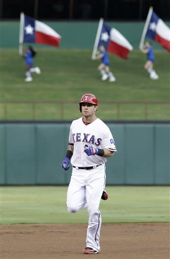 Texas Rangers' Josh Hamilton rounds the bases after his solo home run during the fist inning of a baseball game against the Detroit Tigers, Friday, Aug. 10, 2012, in Arlington, Texas. (AP Photo/LM Otero)