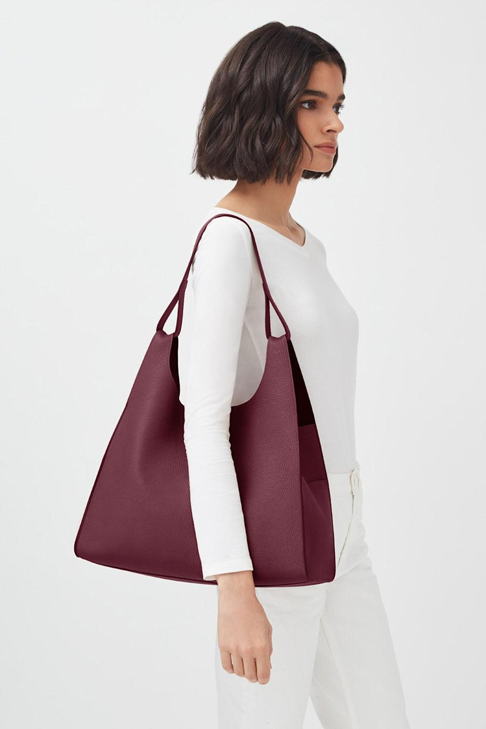 <p>This easy-to-carry <span>Cuyana Oversized Hobo Bag</span> ($395) has useful side pockets.</p>