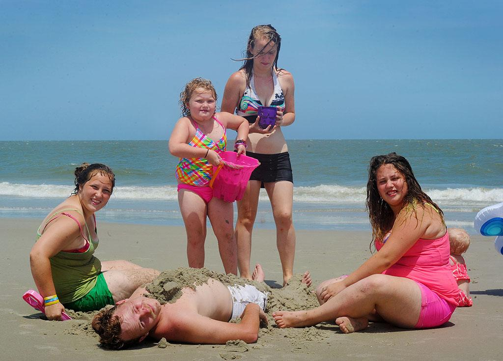"""EXCLUSIVE: **NO WEB Until 1PM PSt** Honey Boo Boo and family hit the beach in Tybee Island, Georgia. The reality family had a few days off from filming their hit TV show 'Here Comes Honey Boo Boo'. Mama June was getting knocked over by the waves and Sugar Bear and their security guard had to go into the water to stand her up. Honey Boo Boo Alana had a blast with a tube tied around her waist while she went for a swim with her Dad Sugar Bear. The sisters buried Uncle Poodle into the sand and also Pumpkin.   Pictured: """"Here Comes Honey Boo Boo""""  Ref: SPL560550 120613  EXCLUSIVE  Picture by: Jason Winslow / Splash News     Splash News and Pictures  Los Angeles:310-821-2666  New York:212-619-2666  London:870-934-2666  photodesk@splashnews.com"""