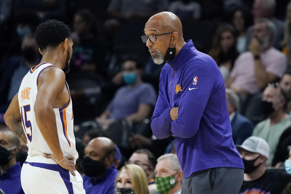 Phoenix Suns coach Monty Williams, right, talks with guard Cameron Payne during the first half of the team's preseason NBA basketball game against the Los Angeles Lakers on Wednesday, Oct. 6, 2021, in Phoenix. The Suns won 117-105. (AP Photo/Ross D. Franklin)