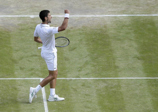 Serbia's Novak Djokovic celebrates winning a game against Spain's Roberto Bautista Agut during a men's singles semifinal match on day eleven of the Wimbledon Tennis Championships in London, Friday, July 12, 2019. (AP Photo/Tim Ireland)