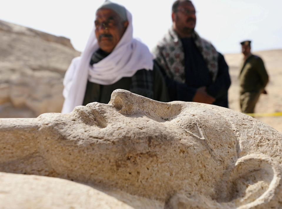 Men secure a stone sarcophagus discovered in an ancient burial site in Minya, Egypt February 24, 2018. REUTERS/Mohamed Abd El Ghany