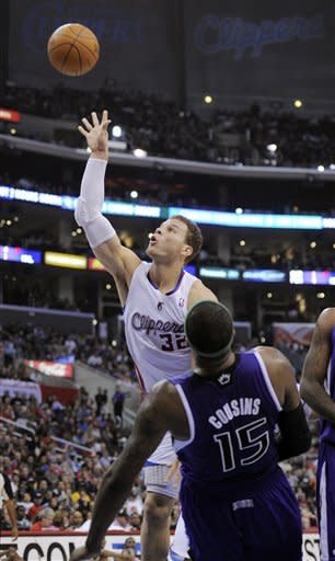 Los Angeles Clippers forward Blake Griffin, left, shoots as Sacramento Kings forward DeMarcus Cousins defends during the first half of their NBA basketball game, Saturday, April 7, 2012, in Los Angeles. (AP Photo/Mark J. Terrill)