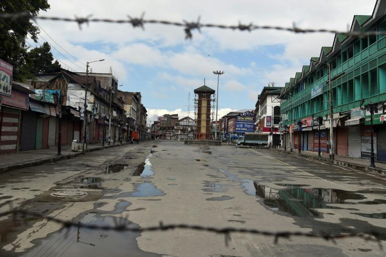 The clock tower and the streets are deserted at Srinagar's usually busy Lal Chowk city square