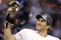 FILE - In this Feb. 5, 2012, file photo, New York Giants quarterback Eli Manning celebrates with the Vince Lombardi Trophy after the Giants' 21-17 win over the New England Patriots in the NFL Super Bowl XLVI football game in Indianapolis. Eli Manning's long and distinguished reign as the Giants' starting quarterback is seemingly over. Let the Daniel Jones era begin. Coach Pat Shurmur announced Tuesday, Sept. 17, 2019, that the No. 6 overall pick in the NFL draft is replacing two-time Super Bowl MVP as the Giants' quarterback, beginning Sunday at Tampa Bay.(AP Photo/Chris O'Meara)