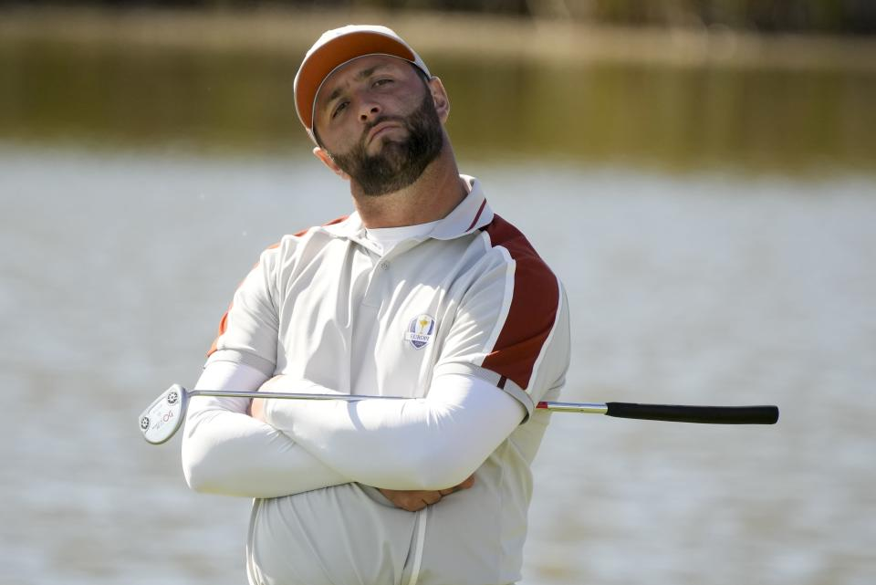 Team Europe's Jon Rahm waits to putt on the fifth hole during a four-ball match the Ryder Cup at the Whistling Straits Golf Course Saturday, Sept. 25, 2021, in Sheboygan, Wis. (AP Photo/Charlie Neibergall)