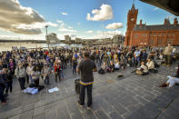 People attend an anti-lockdown protest outside the Senedd Cymru in Cardiff Bay, Wales, Sunday, Oct. 11, 2020. So far the U.K. has experienced Europe's deadliest virus outbreak, with over 42,750 confirmed deaths. (Ben Birchall/PA via AP)