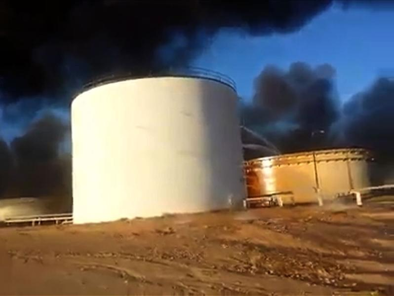 Libya oil storage tanks set on fire during IS assault