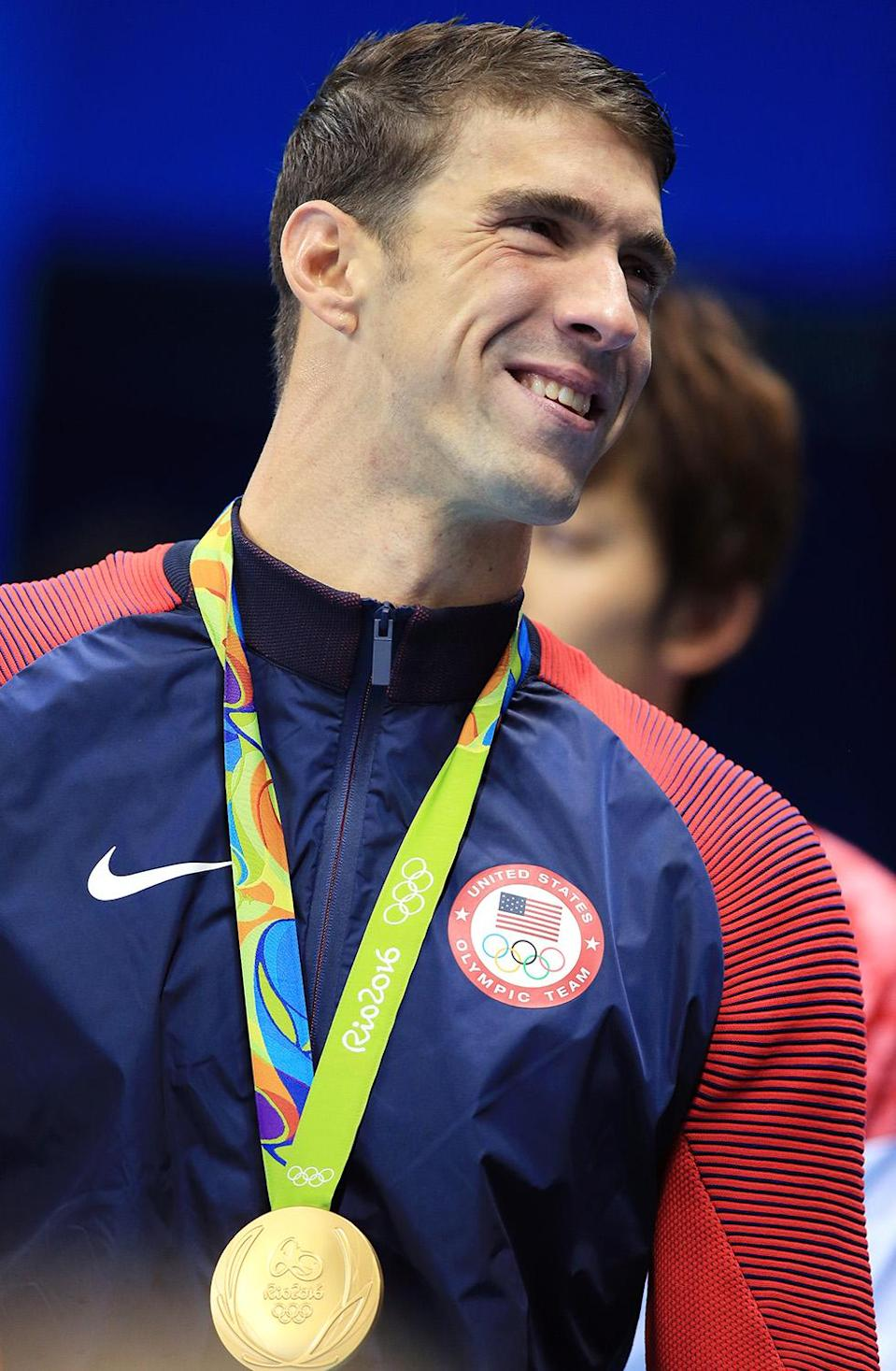 <p>Michael Phelps of the USA wins Gold in the Men's 200m Butterfly Final on Day 4 of the Rio 2016 Olympic Games at the Olympic Aquatics Stadium on August 9, 2016 in Rio de Janerio, Brazil. (Photo by Vaughn Ridley/Getty Images)</p>
