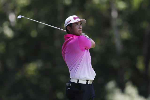 Hideki Matsuyama from Japan hits from the ninth tee during the second round of the Rocket Mortgage Classic golf tournament, Friday, July 3, 2020, at the Detroit Golf Club in Detroit. (AP Photo/Carlos Osorio)