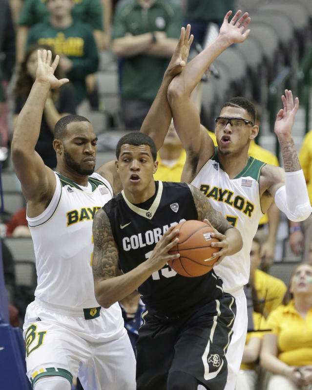 Colorado forward Dustin Thomas (13) looks to pass against Baylor defenders Rico Gathers, left, and Isaiah Austin (21) during the first half of an NCAA college basketball game in Dallas, Friday, Nov. 8, 2013. (AP Photo/LM Otero)