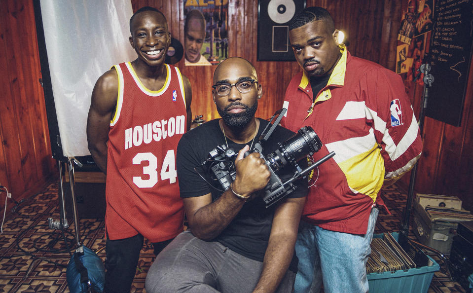 """This image provided by IYO Visuals shows Omete Anassi, who plays Lil Keke, from left, creator/director Isaac Yowman and Rosha Washington who plays DJ Screw, on the set of the visual tribute """"All Screwed Up."""" (IYO Visualls via AP)"""