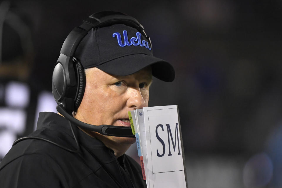 FILE - In this Nov. 30, 2019 file photo, UCLA head coach Chip Kelly stands on the sideline during the second half of an NCAA college football game against California in Pasadena, Calif. Kelly is entering his third year in charge but has only seven wins in his first two seasons. (AP Photo/Mark J. Terrill, File)