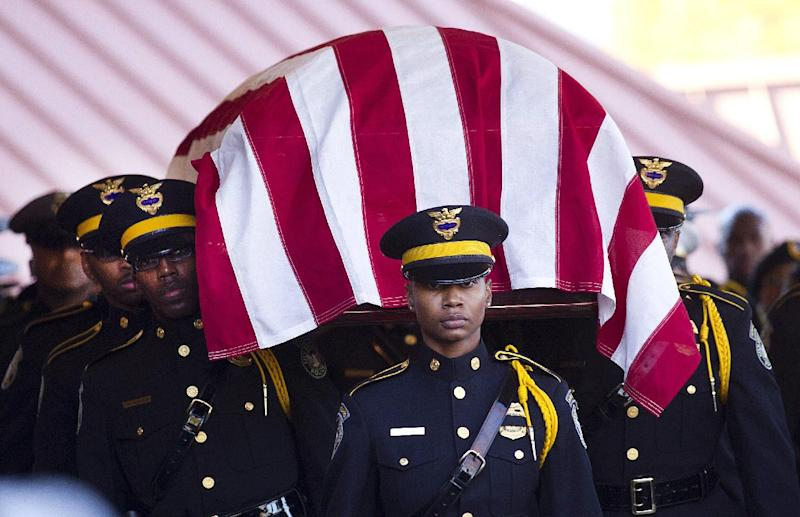 An Atlanta Police honor guard carries the casket containing to remains of Atlanta Police helicopter pilot Richard J. Halford during a memorial service Friday, Nov. 9, 2012 in Atlanta. Halford was one of two officers killed last Saturday night in a helicopter crasher while assisting in a search for a missing child. (AP Photo/John Bazemore)