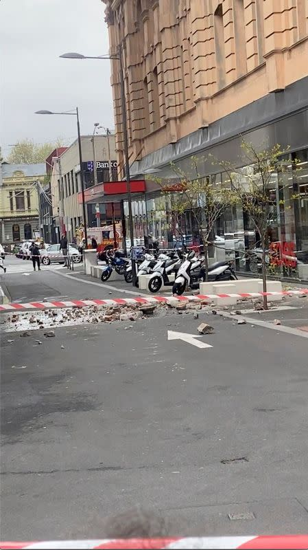 Debris from a damaged building are seen on a road in Prahran, after a magnitude 6.0 earthquake struck near Melbourne, Victoria, Australia