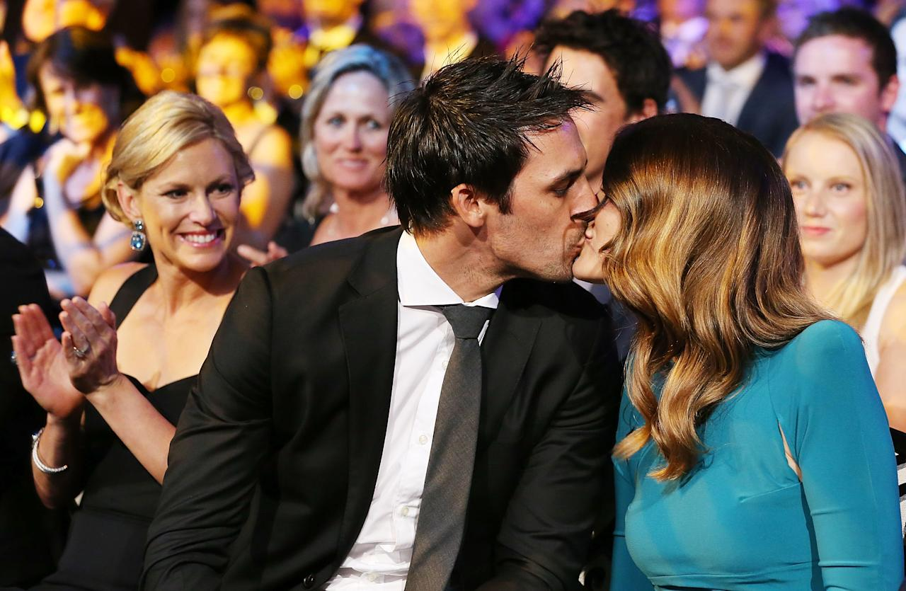 SYDNEY, AUSTRALIA - JANUARY 20:  Mitchell Johnson is kissed by his wife Jessica Bratich-Johnson after winning the Allan Border Medal during the 2014 Allan Border Medal at Doltone House on January 20, 2014 in Sydney,  (Photo by Mark Metcalfe/Getty Images)