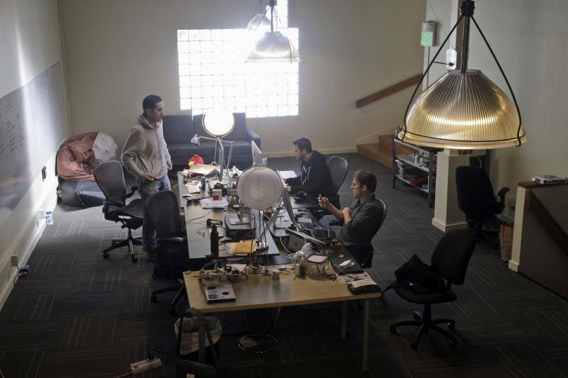 """In this April 7, 2011 photo, CEO Kevin Systrom, at left, chats with engineers Shayne Sweeney, center, and MIke Krieger at Instagram in San Francisco. The mobile photo sharing service Instagram launched in October. Since then, the service has grown to about 3 million registered users, or an average of a half-million new users each month.  Despite raising $7 million from investors the company has no plans to go on a hiring spree or seek to cash in on a quick public stock offering, the stereotypical scenario during the first Internet boom.  """"It's about going after the best people in the world who want to build a world-class company,"""" Systrom said. """"We are pretty sold at staying lean for quite awhile.""""  (AP Photo/Marcio Jose Sanchez)"""