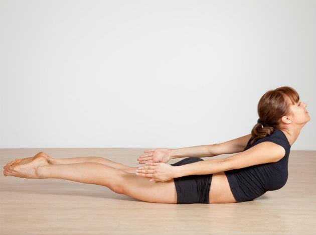 <b>Locust Pose</b> <br> Lie down flat on your yoga mat, with your face facing down. Stretch out your legs and arms as far wide as possible. Keeping both arms and legs absolutely straight, lift the head, arms, chest and legs all at the same time. Maintain this position for a few seconds before slowly lowering all parts simultaneously. Repeat.