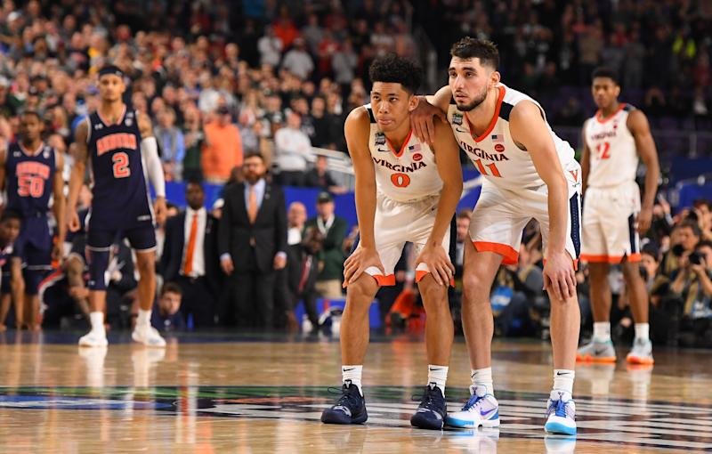 MINNEAPOLIS, MINNESOTA - APRIL 06: Kihei Clark #0 of the Virginia Cavaliers and Ty Jerome #11 of the Virginia Cavaliers watch a free throw late in the semifinal game in the NCAA Men's Final Four at U.S. Bank Stadium on April 06, 2019 in Minneapolis, Minnesota. (Photo by Jamie Schwaberow/NCAA Photos via Getty Images)