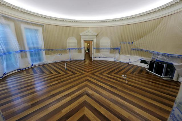 <p>The Oval Office of the White House sits emptied of all furniture, carpet and other decor during renovations at the White House in Washington, Aug.11, 2017. (Photo: Jim Bourg/Reuters) </p>
