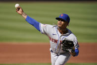 New York Mets starting pitcher Marcus Stroman throws during the first inning in the first game of a baseball doubleheader against the St. Louis Cardinals Wednesday, May 5, 2021, in St. Louis. (AP Photo/Jeff Roberson)