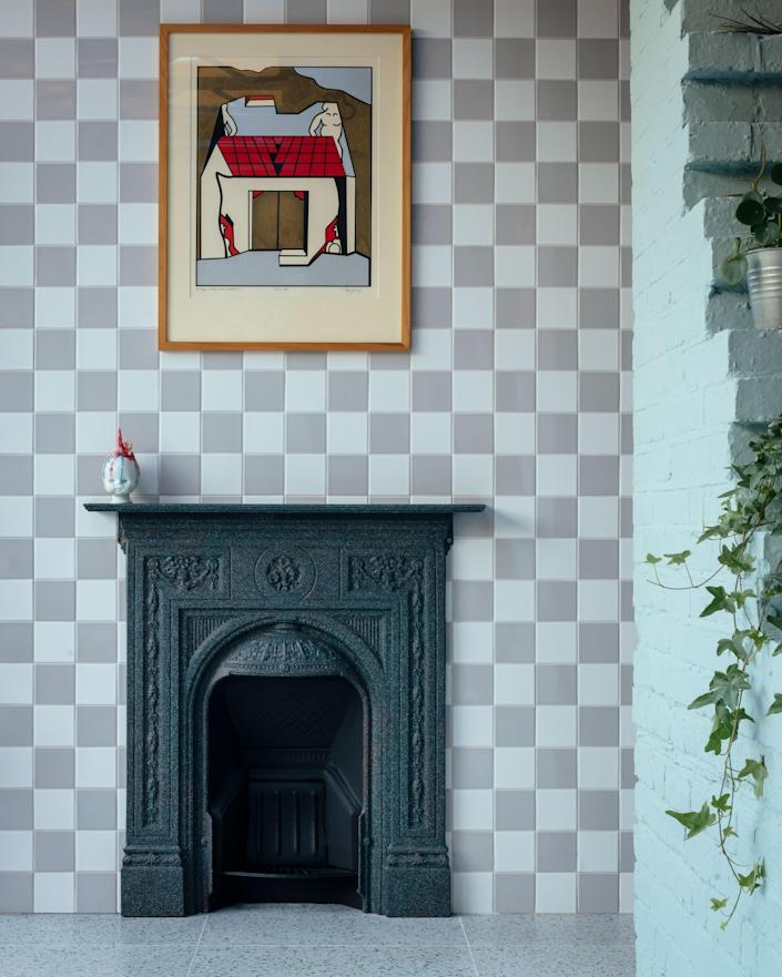 """When we were uncovering the existing elements in the house, we came across the original fireplaces and they all had checkerboard tiles as a hearth,"" Mat says of the impetus for the recurring pattern."