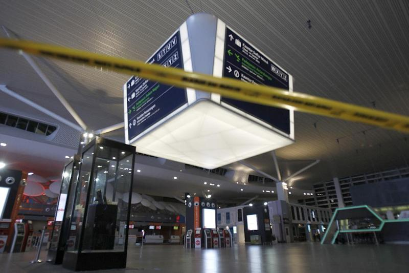 Tape blocks the entrance to the main hall of Kuala Lumpur International Airport 2 for the decontamination process in Sepang, Malaysia on Sunday, Feb. 26, 2017. Malaysian police ordered a sweep of Kuala Lumpur airport for toxic chemicals and other hazardous substances following the killing of Kim Jong Nam. (AP Photo/Daniel Chan)