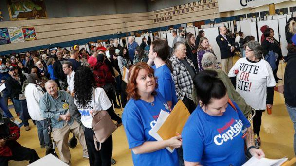 PHOTO:Nevada voters line up to participate in the caucus at Cheyenne High School in North Las Vegas, Feb. 22, 2020. (Shannon Stapleton/Reuters)