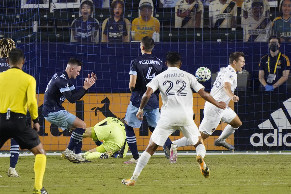 Los Angeles Galaxy's Kai Koreniuk, right, celebrates as he scores a goal during the second half of an MLS soccer match against the Vancouver Whitecaps, Sunday, Oct. 18, 2020, in Carson, Calif. (AP Photo/Marcio Jose Sanchez)