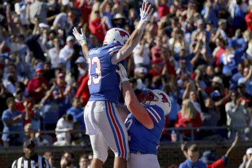 SMU tight end Kylen Granson, left, celebrates after a touchdown catch with offensive guard Nick Dennis, right, during the second half of an NCAA college football game, Saturday, Nov. 9, 2019, in Dallas. (AP Photo/Roger Steinman)